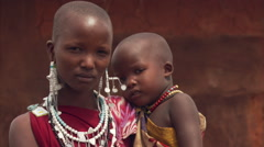 Portrait of young Masai woman and child in Tanzania Stock Footage
