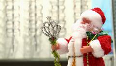 Santa Claus on a background of a shelf with glasses for vision. Stock Footage