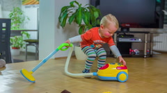 Boy with cute tights is vacuum cleaning - stock footage