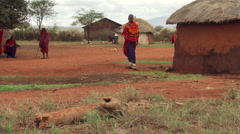 Young Masai man demonstrating his marksmanship with a spear Stock Footage