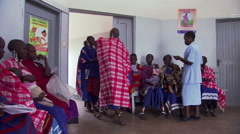 Women and children in waiting room of Tanzanian clinic Stock Footage