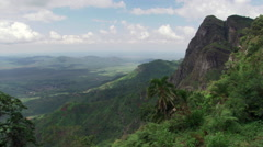 Tanzania's Irente Viewpoint, right pan to village women walking down mountain Stock Footage