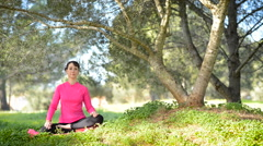 young caucasian woman practicing meditation outdoors - stock footage