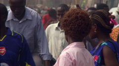 Close-up of pedestrians and other traffic on a street in Kampala, Uganda Stock Footage