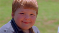 Close-up round face of a smiling chubby little boy - stock footage