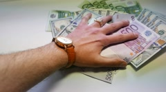 Hand takes dollars and euros Stock Footage
