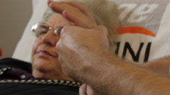 Physiotherapist doing exercises with injured hand of old female patient,close up Stock Footage