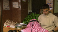 Close pan of activity in a crowded Israeli marketplace Stock Footage