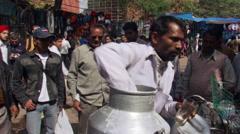 Milk vendor in New Delhi marketplace Stock Footage