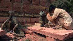 Stonecutters doing repair work at Agra Fort Stock Footage