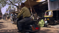 Busy street scene and bicycle shop near Agra Stock Footage