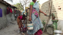 Women doing family laundry in a neighborhood alleyway in Calcutta Stock Footage