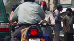 Traffic approaching camera on busy street in Calcutta Stock Footage