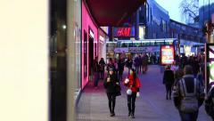 Crowd of People in Shopping Mall, Pan From Shop Window Stock Footage