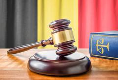 A gavel and a law book - Belgium - stock photo