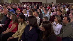 Wide view of seated congregation listening to out-of-frame speaker - stock footage