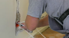 Electrician is installing new electric wires Stock Footage