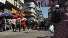Hong Kong: Shoppers along a street Stock Footage
