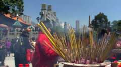 Hong Kong: Lighting incense for Chinese New Year Stock Footage