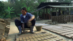 Thailand: Brickmaker forming bricks at a brickyard Stock Footage