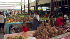 People buying produce at an open-air marketplace in Fiji Stock Footage