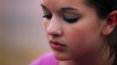 Close-up face of a teenage girl appearing about to cry Stock Footage