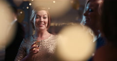 Beautiful woman dancing having fun at glamorous sexy party drinking alcohol Stock Footage