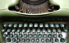 Vintage green typewriter - stock photo