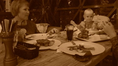 Child in restaurant, old style sepia view with grain Stock Footage