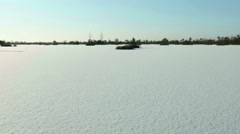 Frozen lake under the snow. Clean and frosty daytime. Smooth dolly shot. Stock Footage