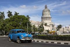 Stock Photo of Cuba, Havana, old car near Capitolio