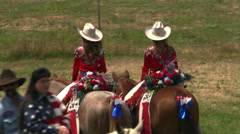 Rear view of two mounted rodeo princesses Stock Footage