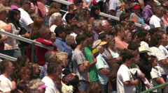 Grandstand crowd applauding national anthem at a rodeo - stock footage