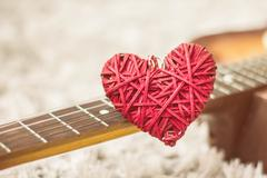 Stock Photo of Love Red Heart on the guitar , romance and music, Valentine day
