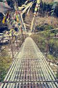 Metal suspension bridge. - stock photo