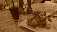 Dinner with a chiken, old style sepia view with grain Stock Footage