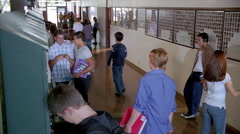 Raised view of  high school hallway during a break between classes Stock Footage