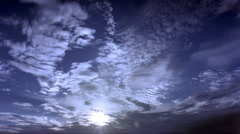 Time-lapse scattered clouds and bright sun Stock Footage