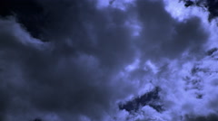Time-lapse clouds drifting in front of the moon Stock Footage