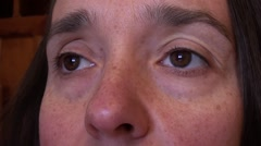 Eyes and nose of woman in her 40th Stock Footage