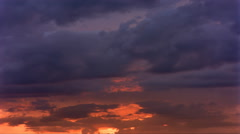 Time-lapse gold and gray sunset clouds - stock footage