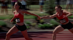 Woman relay racer dropping the baton, switch from real-time to slow motion Stock Footage