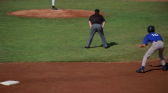 Runner tagged out while trying to steal a base, viewed in slow motion from - stock footage