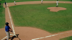 Elevated view of play at plate as runner steals home Stock Footage
