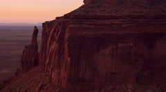 Flying over Eagle Rock to panorama of Monument Valley Stock Footage