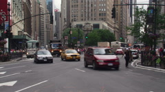 Traffic and pedestrians on 34th and Broadway in New York City Stock Footage