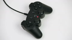 Gamepad on a white background - stock footage