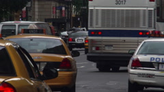 Close-up of taxis and police cars at 34th and Broadway in New York City - stock footage