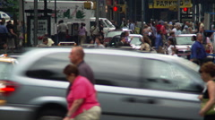 Pedestrians crossing NYC street in front of waiting traffic Stock Footage