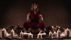 Woman playing a singing bowls Stock Footage